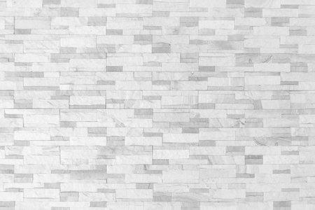 Sandstone wall background of white sand stone jigsaw tile, rock brick modern texture pattern for backdrop decoration 版權商用圖片