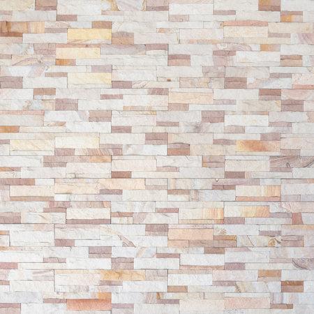 Sandstone wall background of white golden sand stone jigsaw tile, rock brick modern texture pattern for backdrop decoration 版權商用圖片