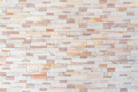 Sandstone wall background of white golden sand stone jigsaw tile, rock brick modern texture pattern for backdrop decoration Standard-Bild