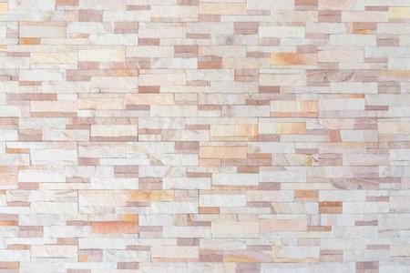 Sandstone wall background of white golden sand stone jigsaw tile, rock brick modern texture pattern for backdrop decoration Zdjęcie Seryjne - 161217000