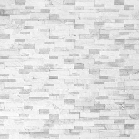 Sandstone wall background of white sand stone jigsaw tile, rock brick modern texture pattern for backdrop decoration Standard-Bild