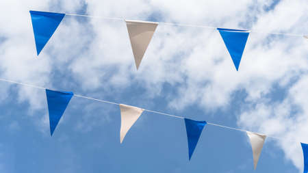 Fair flag bunting colorful background hanging on blue sky for fun fiesta party event, summer holiday farm feast celebration, carnival festival event, park or street festa design decoration 版權商用圖片