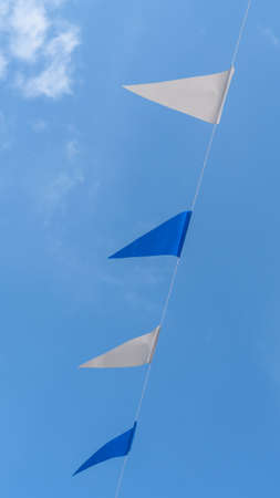 Fair flag bunting colorful background hanging on blue sky for fun fiesta party event, summer holiday farm feast celebration, carnival festival event, park or street festa design decoration Zdjęcie Seryjne - 161217005