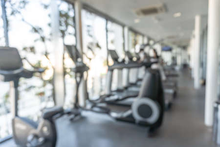 Gym blur background fitness center, workout personal training studio, health club with blurry sports exercise equipment for aerobic, bodybuilding and power strength class Zdjęcie Seryjne - 161329593
