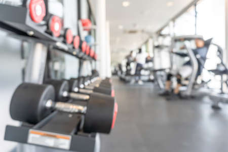 Gym blur background fitness center, workout personal training studio, health club with blurry sports exercise equipment for aerobic, bodybuilding and power strength class