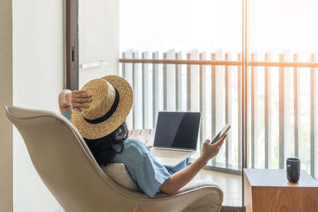 Life-work balance, relaxation healthy quality living lifestyle in summer holiday vacation of freelancer woman take it easy resting in resort hotel balcony having peace of mind Zdjęcie Seryjne