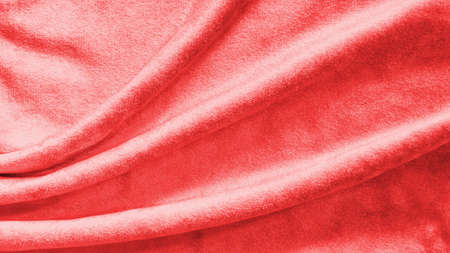 Red velvet background or velour flannel texture made of cotton or wool with soft fluffy velvety satin fabric cloth rose gold metallic color material Zdjęcie Seryjne