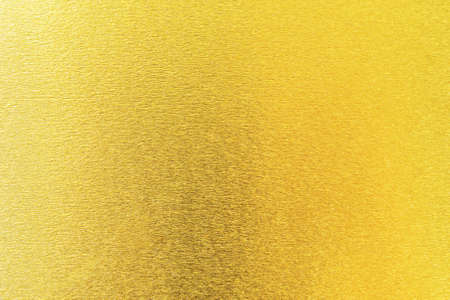 Gold texture background metallic golden foil or shinny wrapping paper bright yellow wall paper for design decoration element 版權商用圖片