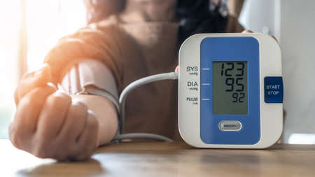 Blood pressure monitoring with digital sphygmomanometer for patient with hypertension or high blood pressure illness by self-check on health at home