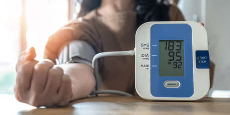 Hypertension or high blood pressure illness in patient with blood pressure monitoring, measurement on digital sphygmomanometer for self-check on health at home