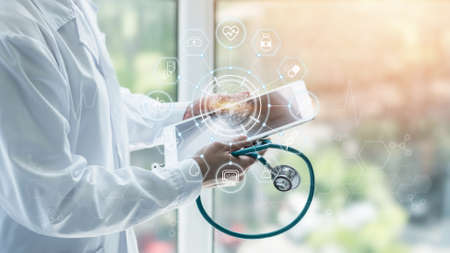 Medical tech science, innovative iot global healthcare ai technology, World health day with doctor on telehealth, telemedicine service analyzing online on EHR, EMR patient digita data on tablet in lab Zdjęcie Seryjne