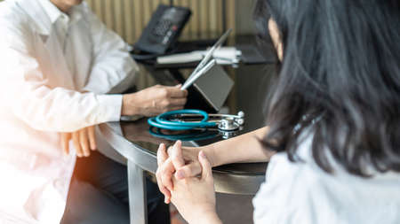 Menopause woman, stressful patient consulting with doctor or psychiatrist counselor who diagnostic examining on mental health illness or obstetric - gynaecological disorder in medical clinic office