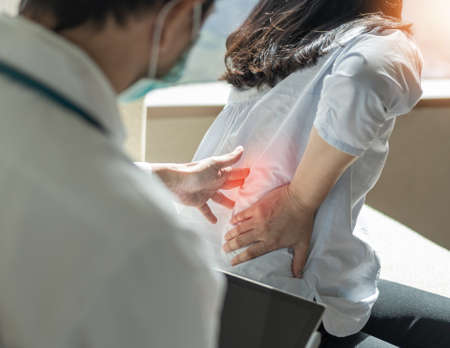 Lower back pain, back ache, muscle or spine injury in menopause woman patient with backache from osteoporosis disease or office syndrome seeing orthopedic surgical doctor for medical treatment Zdjęcie Seryjne