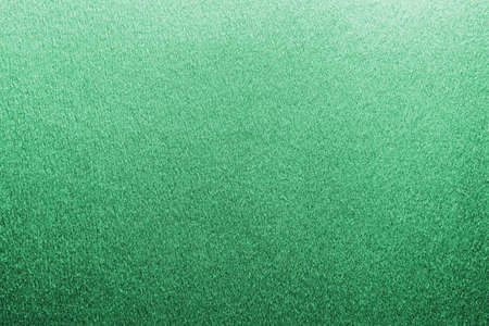 Green metallic foil texture background for Christmas and Saint Patrick's day holiday decoration wallpaper backdrop design Stock Photo