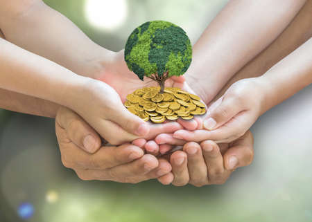 Global sustainable investment fund with environment, social, governance (ESG) and CSR policy concept with family hands holding world globe tree growing on money coin capital wealth