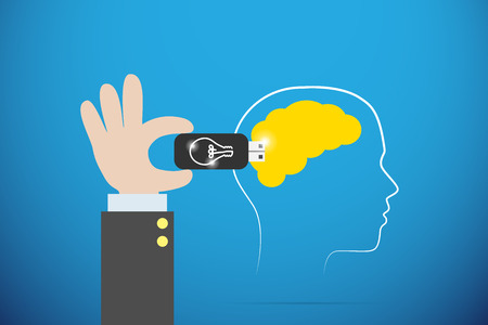 business hand plugging lightbulb flash drive on yellow brain, idea and coaching concept