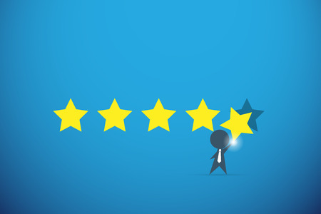 businessman holding gold star for rating, quality and business concept
