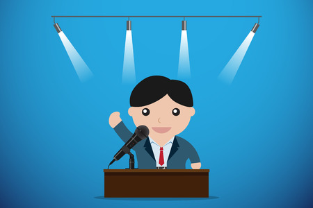 businessman speaking with microphone behind a table, speech and business concept
