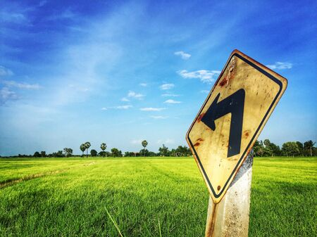 Traffic sign with rice field with blue sky
