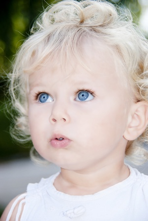 Cute blond baby girl with blue eyes