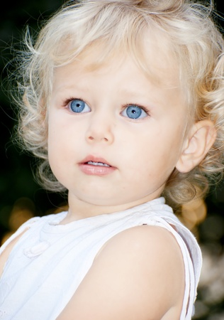 Cute blond baby girl with blue eyes photo