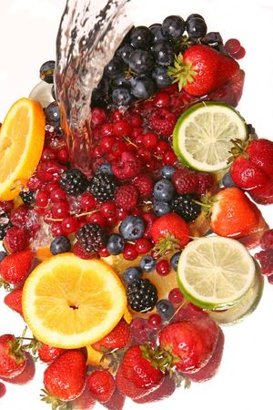 coco: water splash and fruits Stock Photo