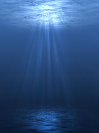 An underwater scene with sunrays shining through the waters glittering and moving surface.