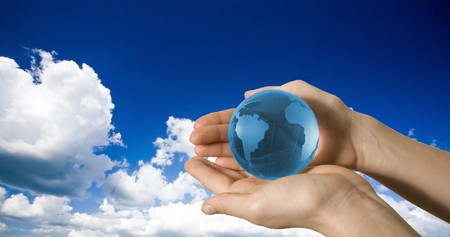 the humanities landscape: Earth globe in hands protected. Ideal for Earth protection concepts, recycling, world issues, enviroment themes