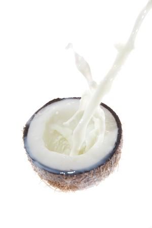 Coconut with coconut milk splash photo