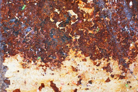Plate of metal rusty on all background, with old layers of a paint Stock Photo - 4401415