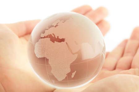 hand holding globe to protect the fragile environment Stock Photo - 9103283