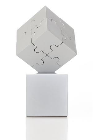 Gray cube of puzzles on white background  photo