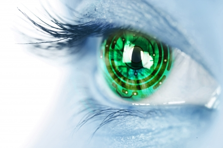 eye closeup: eye iris and green  electronic circuit