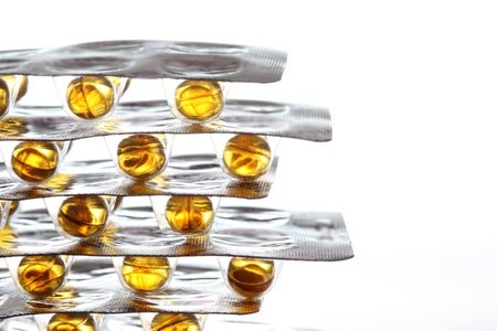 package of fish oil pills over the white background  Standard-Bild