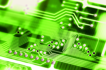 Closeup of a green computer circuit board  technological background  photo