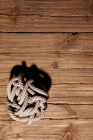 Ropes on a wooden background Stock Photo - 13923114