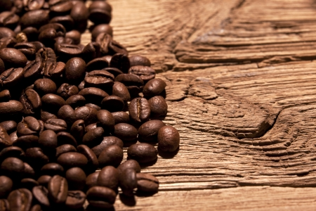 Fresh coffee beans on wood photo