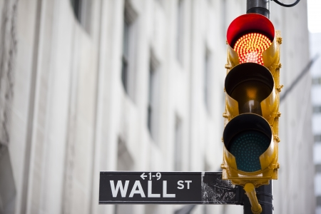 Wall street and red traffic  light photo