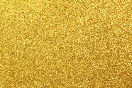 gold textured background: Detailed texture of glittering golden dust surface