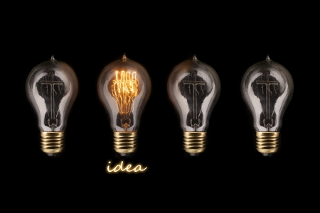 tungsten: One glowing light bulb amongst other light bulbs, concept of idea  Stock Photo