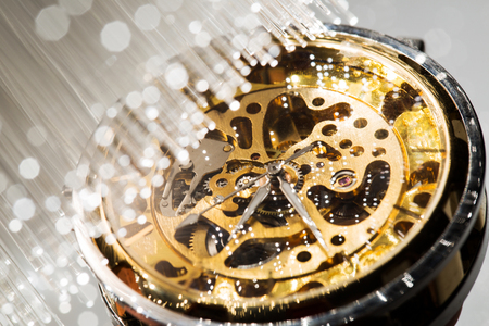 watchmaker: close view of watch mechanism and Fiber optics background