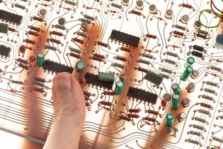 electric circuit: human hand  with electric circuit