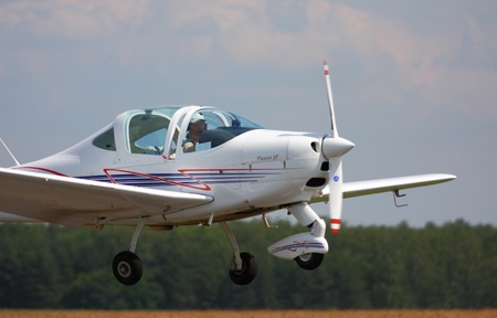pilotage: Landing and training flight sports-flight plane Tecnam Sierra 2002  from airfield Severka 03 jule 2011, Moskow, Russian Federation