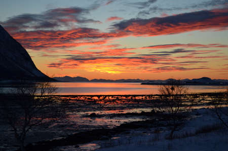 Colourful sunset on the island of Senja photo