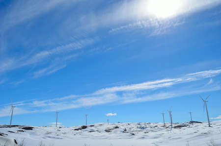 artic circle: Windmill farm on top of a mountain in Norway with clear blue sky background Stock Photo