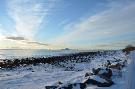 Sea shore at winter on the island of Senja photo