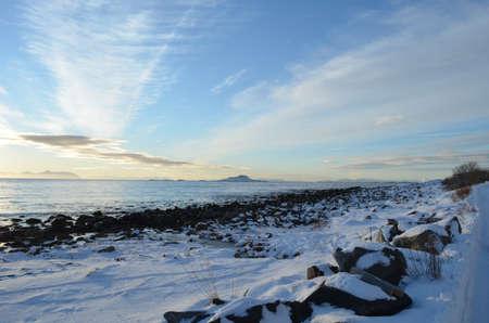 Sea shore at winter on the island of Senja photo