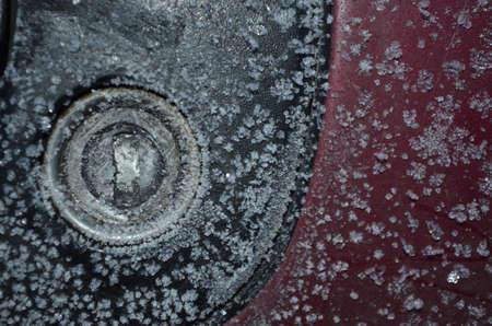 sub zero: frozen car door lock with ice crystals macro photo