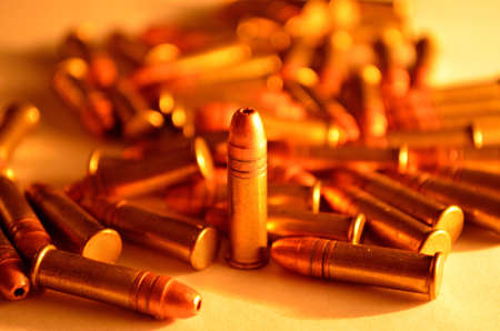 single bullet standing in a pile Stock Photo