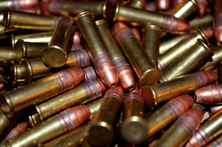 caliber: pile of 22 caliber ammonition in a pile close up